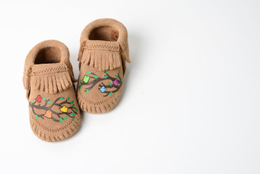 """""""We Are Family"""" Minnetonka Moccasin Co."""