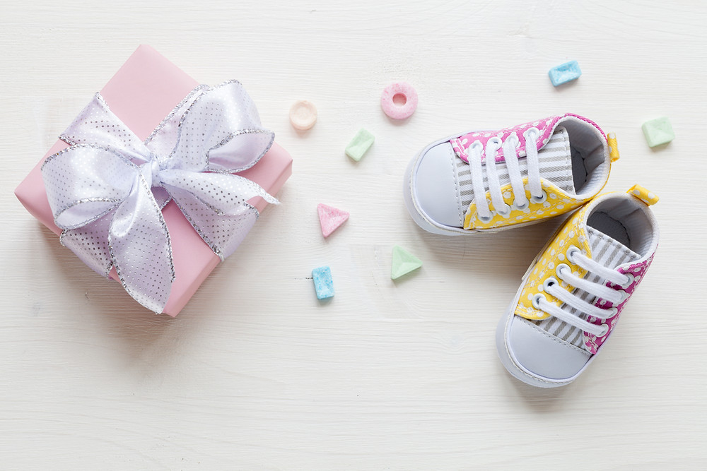 Cute gift box and baby shoes