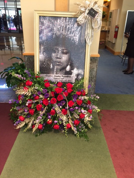 Aretha Franklin in a crown, roses at her feet: A Celebration Fit for a Queen