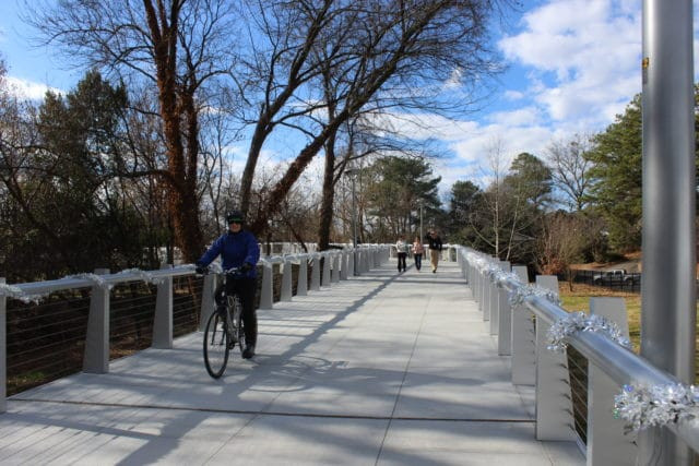 Cyclists and pedestrians on the Peachtree Creek Greenway at the Dec. 12 grand opening. (Dyana Bagby)