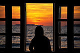 silhouette-young-woman-looking-through-w