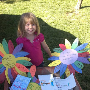 Elementary school fan Gracie Keep delivers a wheelbarrow filled with fan letters to Michael Darby and Smile from Las Vegas Elementary schools!!!!