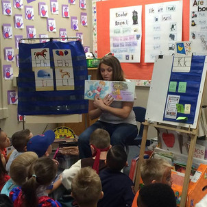 """Ashley aka Smile reading """"I Have a Friend Who..."""" to May Elementary School."""