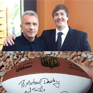 Michael Darby meeting with NFL player Joe Montana.
