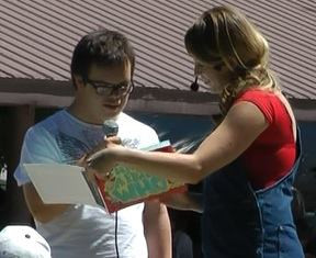 """Ashley aka Smile having their new friend Max reading a page from their book """"I Have a Friend Who."""""""
