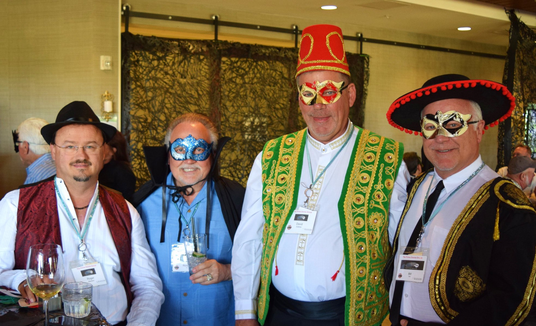 Masquerade Ball - holding up their end of the bar.jpg
