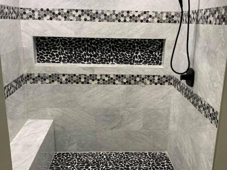 Custom Shower: Marble and Glass Hexagon with Shower Pan Pebbles.