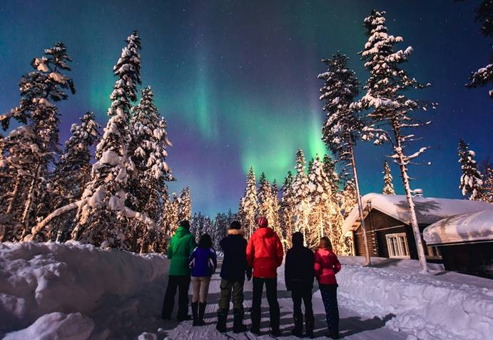 People looking at the northern lights in Sweden