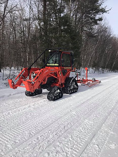 KTSR Kubota with tracks and drag from ea