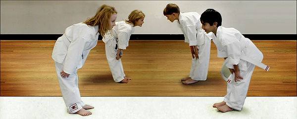 four students bowing.jpg