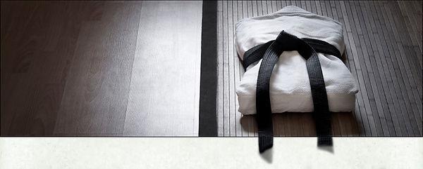 gi and black belt on floor.jpg