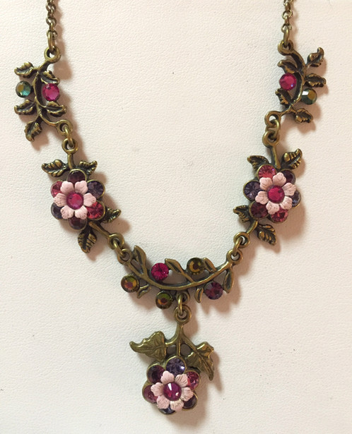 Long pink flower necklace beautiful handmade floral michal negrin necklace decorated with brass ornaments swarovski crystals and glass bead the necklace is accented with a flower mightylinksfo