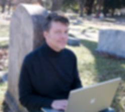 Glen Coburn writes his new book in cemetery full of ghosts