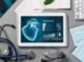 White tablet pc and doctor tools on gray