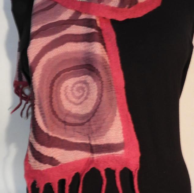 Hand painted nuno feltedspirals on pink