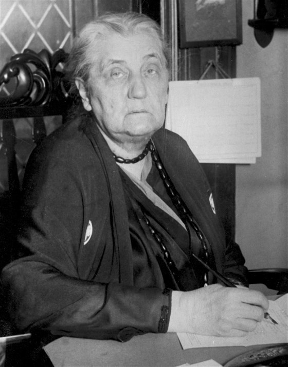 Jane Addams poses for a portrait at her desk in Hull House in Chicago, Ill., Dec. 9, 1931.