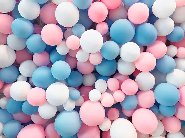 Many colorful balloons decorated wall as