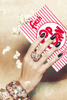 woman-eating-popcorn-black-glitter-metal