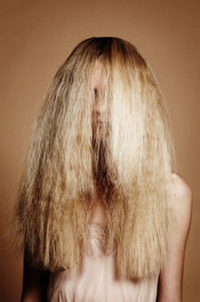 frizzy-hair-in-face-covering-womans-face