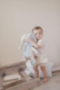 Baby boy on rocking horse