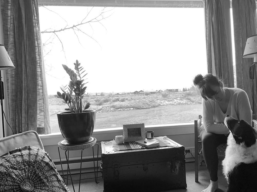 Whitney and her dog sitting, melancholy.