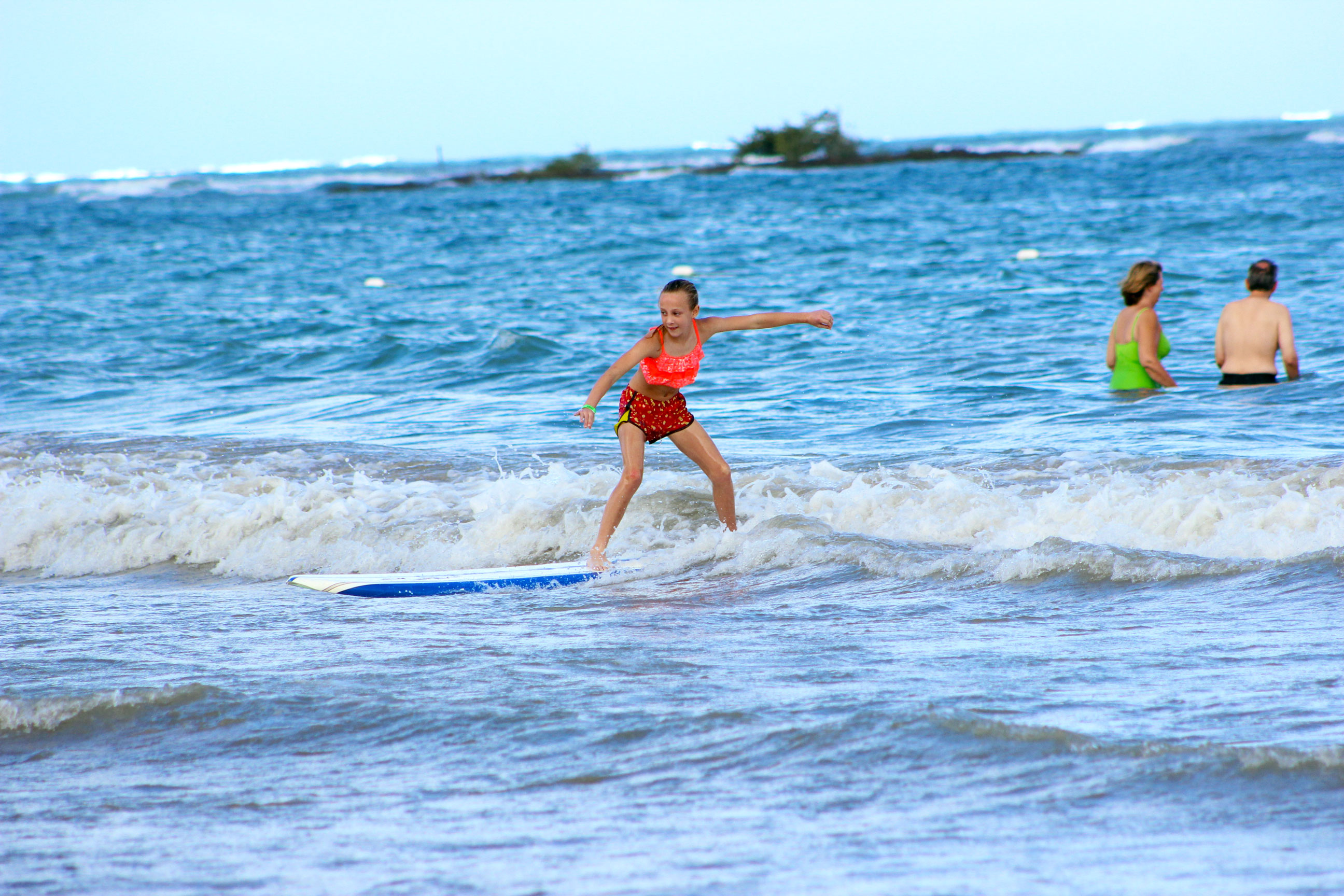 girls surfing lesson