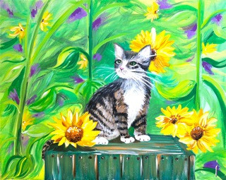 Kitten in sunflowers