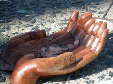 Hands%20with%20Pennies.png