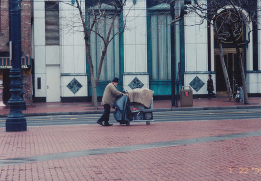 Pushing a cart on Market St.jpg