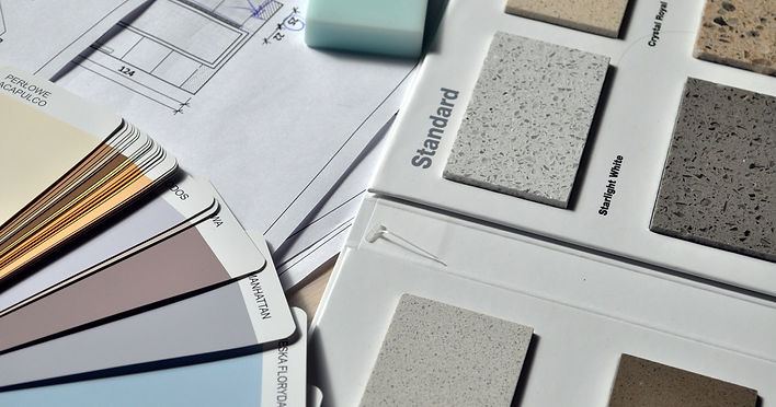 gray-paint-swatch-book-near-tile-samples