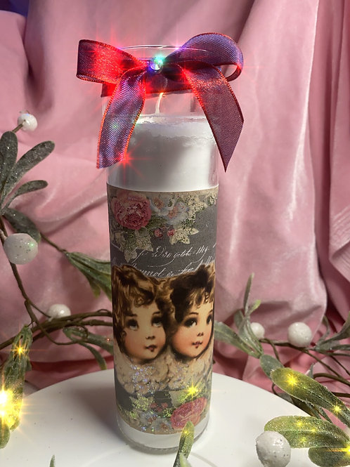 "Candles , hand embellished vintage Christmas prints . 8"" tall"