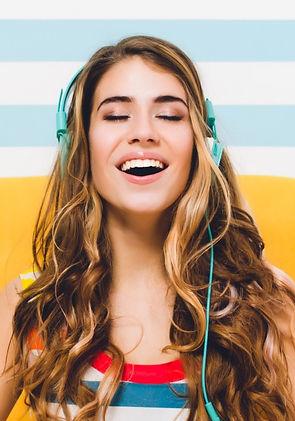 joyful-long-haired-girl-meditating-while