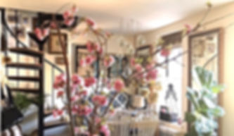 Cherry Blossom Branches in lovely Upper West Side Apartment in NYC with art, mirrors and spiral staircase