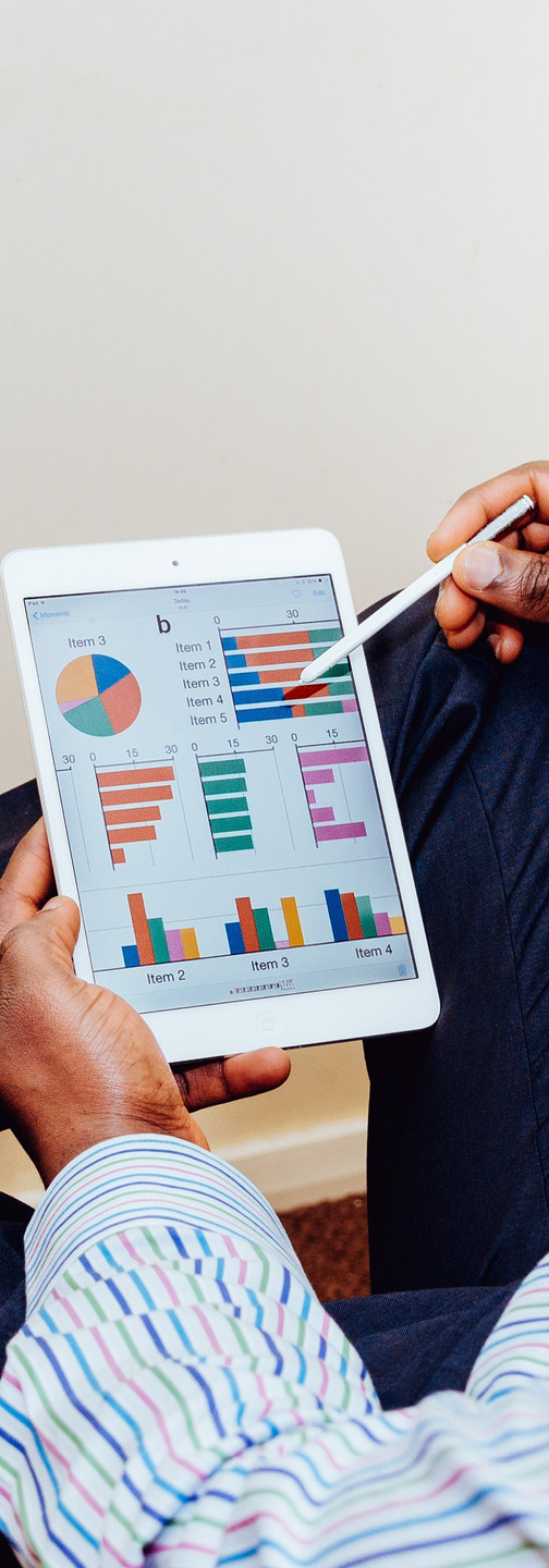 Business owner looks at analytics and target market data on iPad