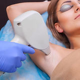 woman-having-laser-hair-removal-on-her-a