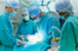 doctors and nurses performing surgery