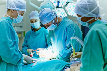 photo of doctors performing surgery