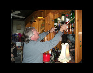 Marvin Whittle plays the whiskey bottles