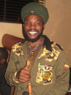 Internationally known Reggae Artists Bushman__Repping CH Warcamo Shirt