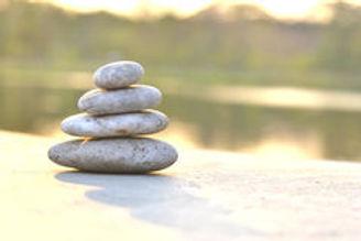 stack-round-smooth-stones-seashore-wood-