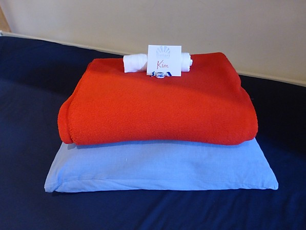 Name card and towels personalized at French hostel
