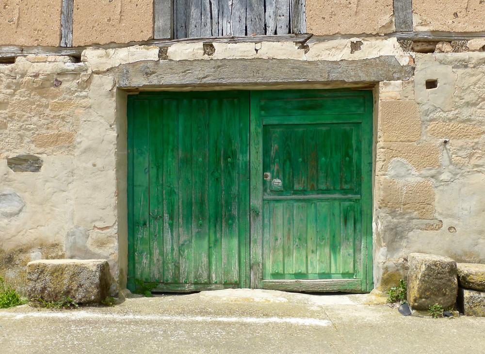 Old wooden green door on Spanish building