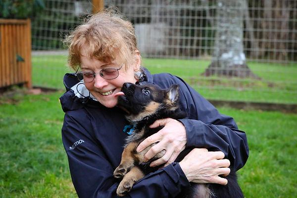 Flood Farm Owner with Puppy