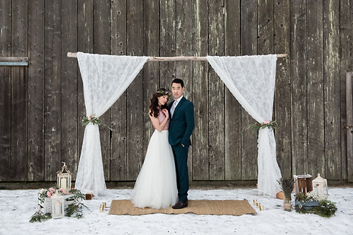 driftwood arbor with lace curtains