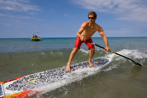 Paddle board surfing