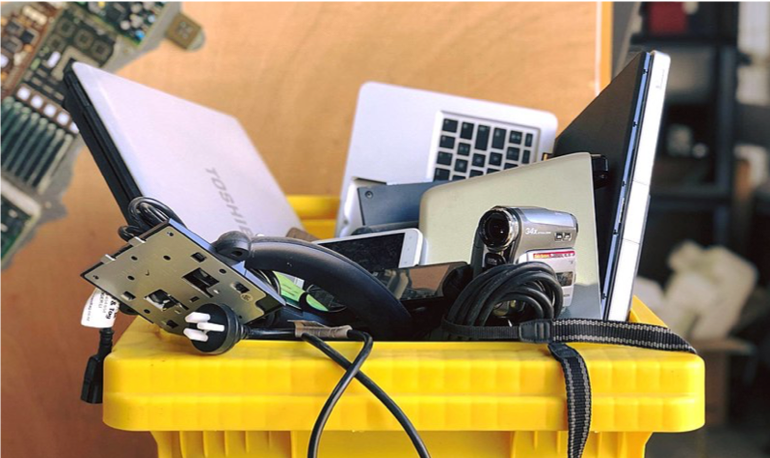 A box of discarded Waste - laptops, camera, plugs