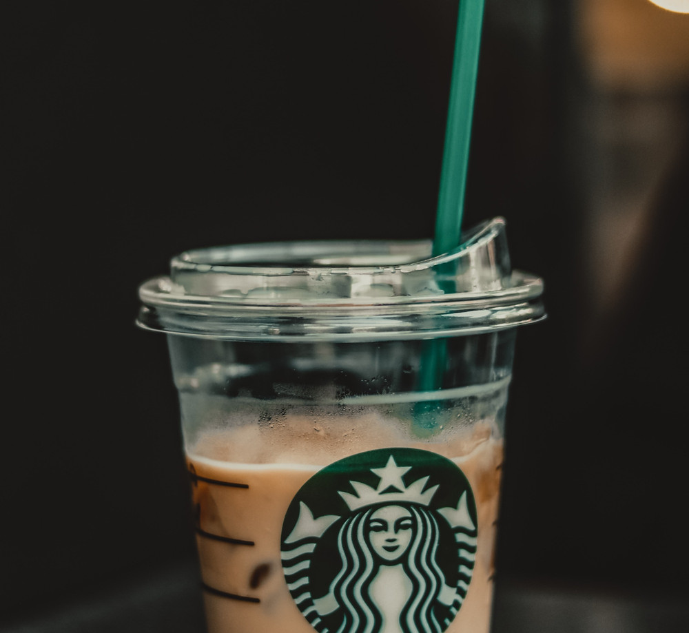 Greenwashing example: The old straw and lid from Starbucks which contains less plastic than their straw-less lid