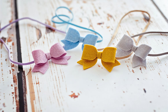Small Dainty Bow Set Of Four