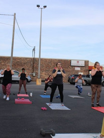 DMF- instructing squat.jpg