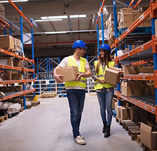 warehouse-workers-carrying-boxes-storage-area-putting-them-shelves.jpg